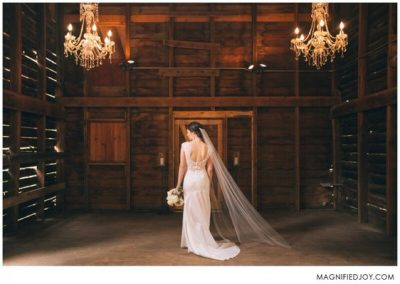 Bride in the rustic, elegant barn ceremony location at Camrose Hill